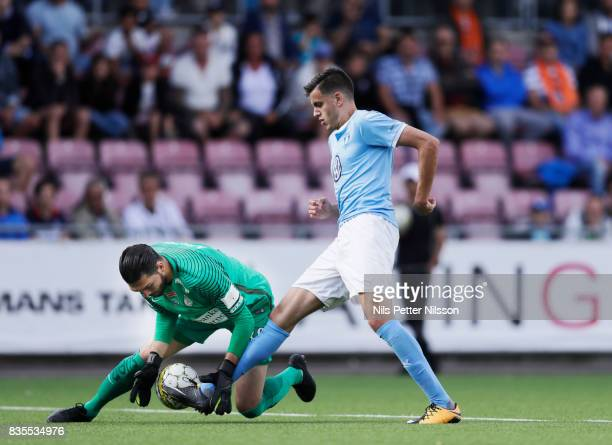 Alireza Haghighi goalkeeperof Athletic FC Eskilstuna makes a save on an attack from Alexander Jeremejeff of Malmo FF during the Allsvenskan match...