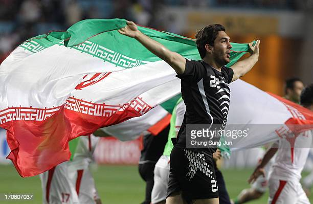 Alireza Haghighi of Iran celebrates qualifying for the 2014 FIFA World Cup following the FIFA 2014 World Cup Qualifier match between South Korea and...