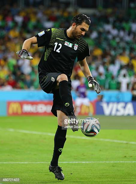 Alireza Haghighi of Iran controls the ball during the 2014 FIFA World Cup Brazil Group F match between Iran and Nigeria at Arena da Baixada on June...