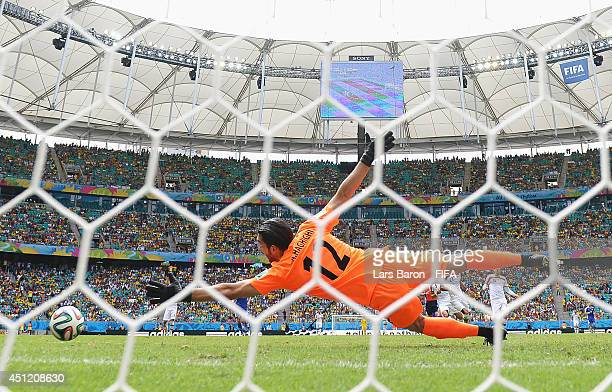 Alireza Haghighi of Iran fails to stop the shot by Edin Dzeko to allow the first goal for Bosnia and Herzegovina during the 2014 FIFA World Cup...