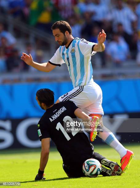 Alireza Haghighi of Iran in action against Gonzalo Higuain of Argentina during the 2014 FIFA World Cup Brazil Group F match between Argentina and...