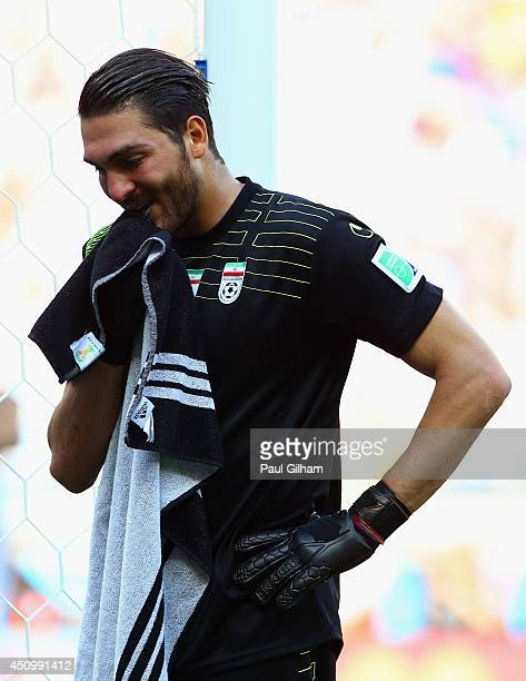 Alireza Haghighi of Iran looks dejected after giving up a goal during the 2014 FIFA World Cup Brazil Group F match between Argentina and Iran at...