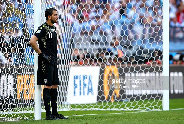 Alireza Haghighi of Iran shows his dejection after allowing the first goal to Argentina during the 2014 FIFA World Cup Brazil Group F match between...