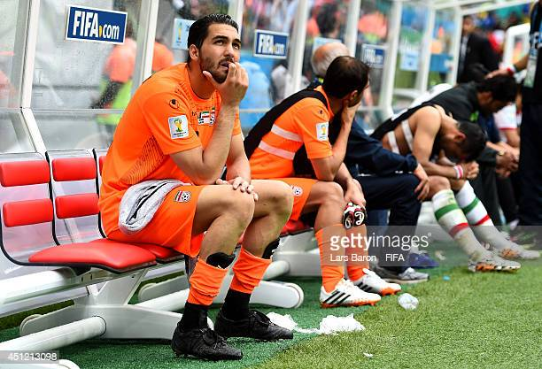 Alireza Haghighi of Iran shows his dejection after the 13 defeat in the 2014 FIFA World Cup Brazil Group F match between BosniaHerzegovina and Iran...