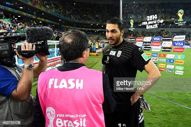 Alireza Haghighi of Iran speaks to the media after the 2014 FIFA World Cup Brazil Group F match between Iran and Nigeria at Arena da Baixada on June...