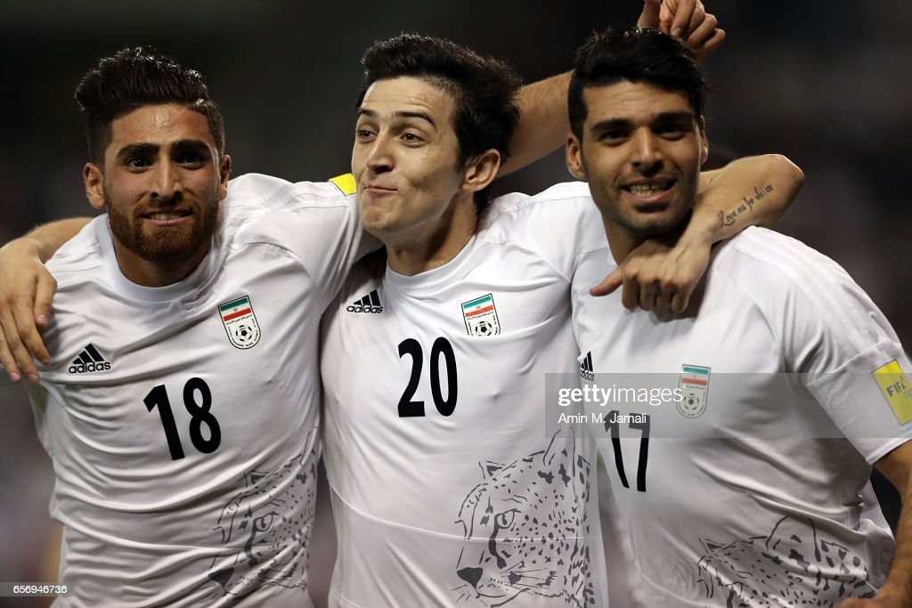 Alireza Jahan Bakhsh (L) and Sardar Azmoun and Mehdi Taremi of Iran celebrate after first goal during Qatar against Iran - FIFA 2018 World Cup Qualifier on March 23, 2017 in Doha, Qatar.
