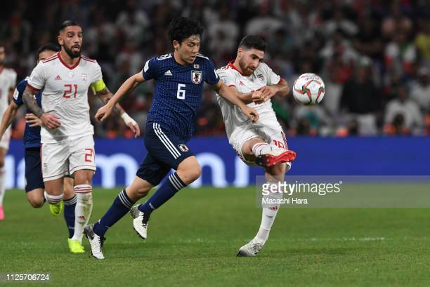 Alireza Jahan Bakhsh Jirandeh of Iran and Wataru Endo of Japan compete for the ball during the AFC Asian Cup semi final match between Iran and Japan...