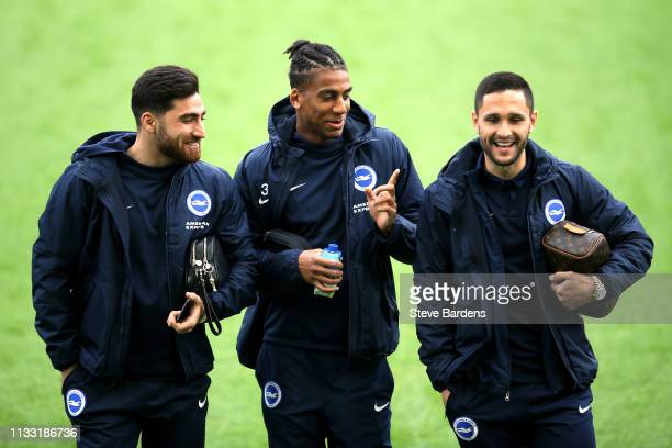 Alireza Jahanbakhsh Bernardo Fernandes da Silva and Florin Andone of Brighton and Hove Albion talk prior to the Premier League match between Brighton...