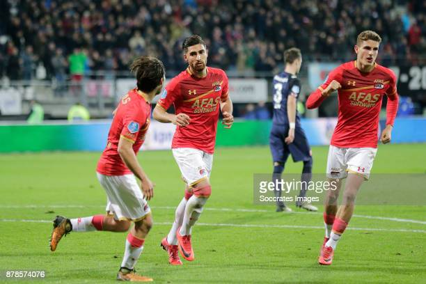 Alireza Jahanbakhsh of AZ Alkmaar celebrates 10 with Joris van Overeem of AZ Alkmaar Guus Til of AZ Alkmaar during the Dutch Eredivisie match between...