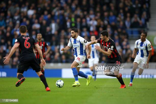 Alireza Jahanbakhsh of Brighton and Hove Albio is challenged by Christopher Schindler of Huddersfield Town during the Premier League match between...