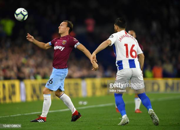 Alireza Jahanbakhsh of Brighton and Hove Albion and Mark Noble of West Ham United in action during the Premier League match between Brighton Hove...