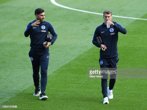 Alireza Jahanbakhsh of Brighton and Hove Albion and Solomon March of Brighton and Hove Albion inspect the pitch prior to the Premier League match...
