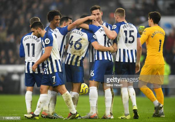 Alireza Jahanbakhsh of Brighton and Hove Albion celebrates with teammates after scoring his team's first goal during the Premier League match between...