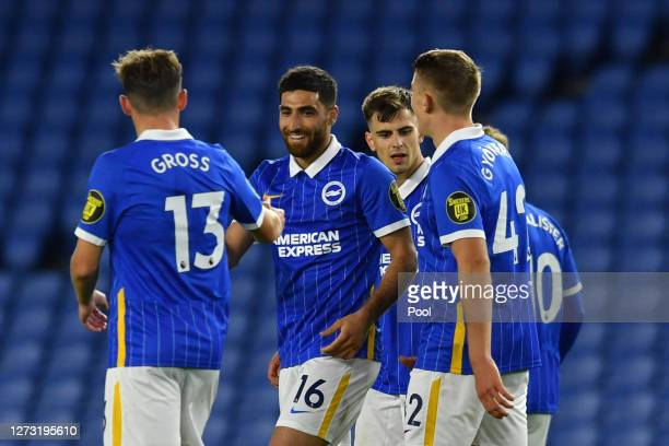 Alireza Jahanbakhsh of Brighton and Hove Albion celebrates with teammates after scoring his sides second goal during the Carabao Cup second round...
