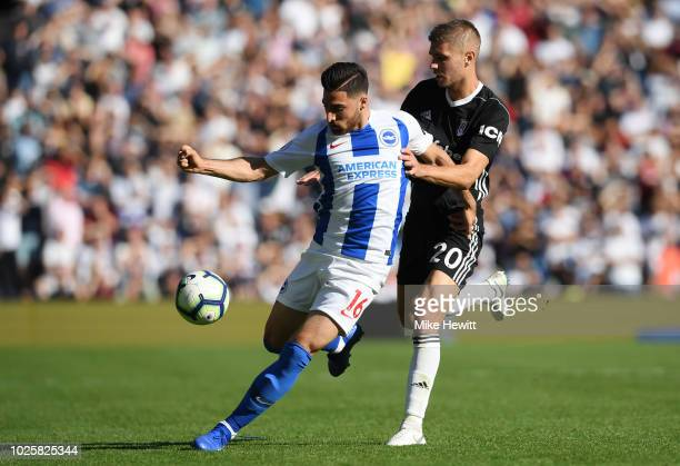Alireza Jahanbakhsh of Brighton and Hove Albion is challenged by Maxime Le Marchand of Fulham during the Premier League match between Brighton Hove...