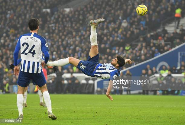 Alireza Jahanbakhsh of Brighton and Hove Albion scores his team's first goal during the Premier League match between Brighton Hove Albion and Chelsea...