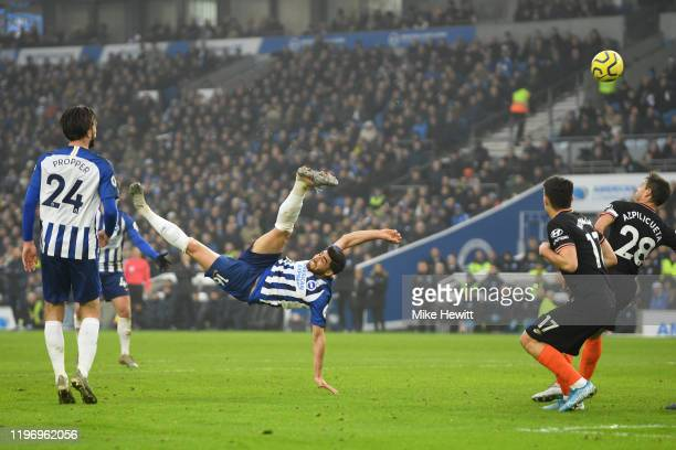 Alireza Jahanbakhsh of Brighton and Hove Albion scores his team's first goal during the Premier League match between Brighton & Hove Albion and...