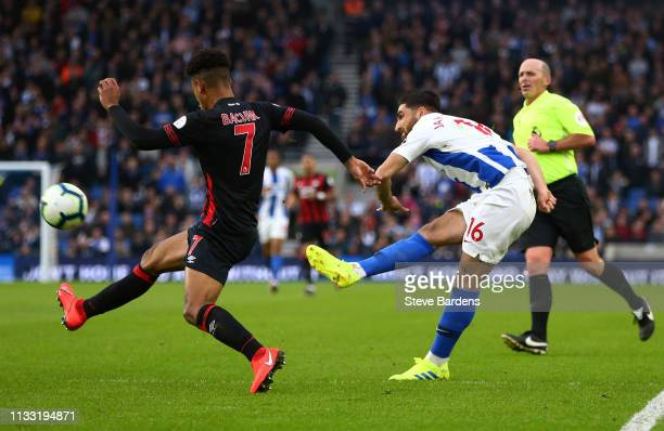 Alireza Jahanbakhsh of Brighton and Hove Albion shoots and hits the cross bar during the Premier League match between Brighton Hove Albion and...