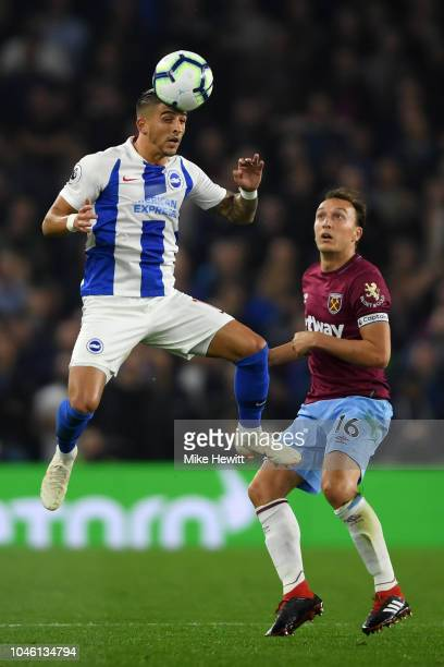 Alireza Jahanbakhsh of Brighton and Hove Albion wins a header over Mark Noble of West Ham United during the Premier League match between Brighton...
