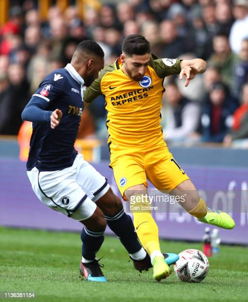 Alireza Jahanbakhsh of Brighton Hove Albion and Mahlon Romeo of Millwall in action during the FA Cup Quarter Final match between Millwall and...