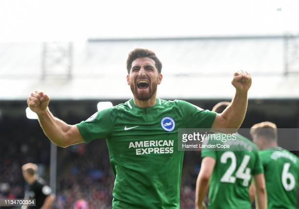 Alireza Jahanbakhsh of Brighton Hove Albion celebrates after teammate Anthony Knockaert scores their team's second goal during the Premier League...