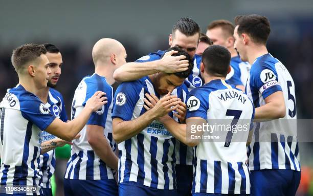 Alireza Jahanbakhsh of Brighton Hove Albion is congratulated by teammates after scoring his teams first goal during the Premier League match between...