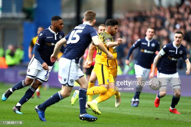 Alireza Jahanbakhsh of Brighton Hove Albion is surrounded by Millwall players during the FA Cup Quarter Final match between Millwall and Brighton and...