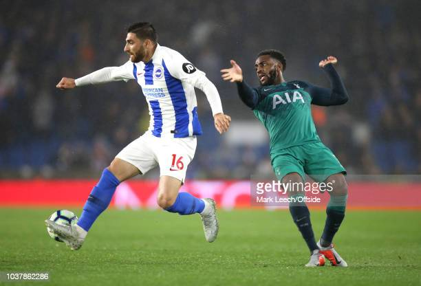 Alireza Jahanbakhsh of Brighton takes the ball from Danny Rose of Tottenham during the Premier League match between Brighton Hove Albion and...