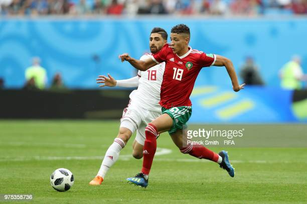 Alireza Jahanbakhsh of Iran battles for possession with Amine Harit of Morocco during the 2018 FIFA World Cup Russia group B match between Morocco...