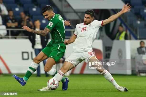 Alireza Jahanbakhsh of Iran battles Safaa Hadi of Iraq during the AFC Asian Cup Group D match between Iran and Iraq at Al Maktoum Stadium on January...