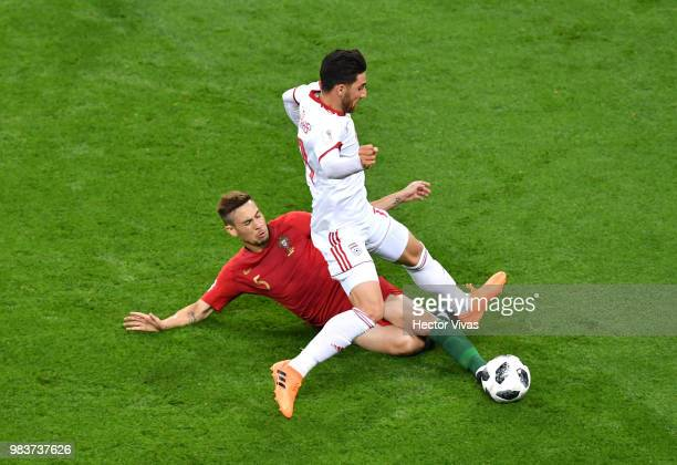 Alireza Jahanbakhsh of Iran is fouled by Raphael Guerreiro of Portugal during the 2018 FIFA World Cup Russia group B match between Iran and Portugal...