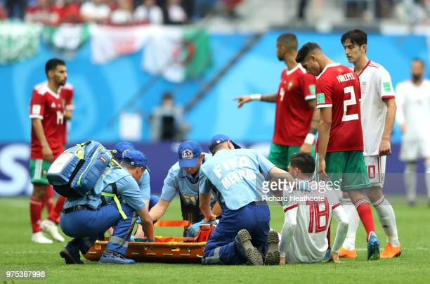 Alireza Jahanbakhsh of Iran receives treatment during the 2018 FIFA World Cup Russia group B match between Morocco and Iran at Saint Petersburg...