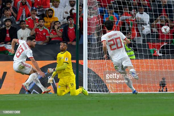Alireza Jahanbakhsh of Iran scores his sides first goal during the AFC Asian Cup round of 16 match between Iran and Oman at Mohammed Bin Zayed...