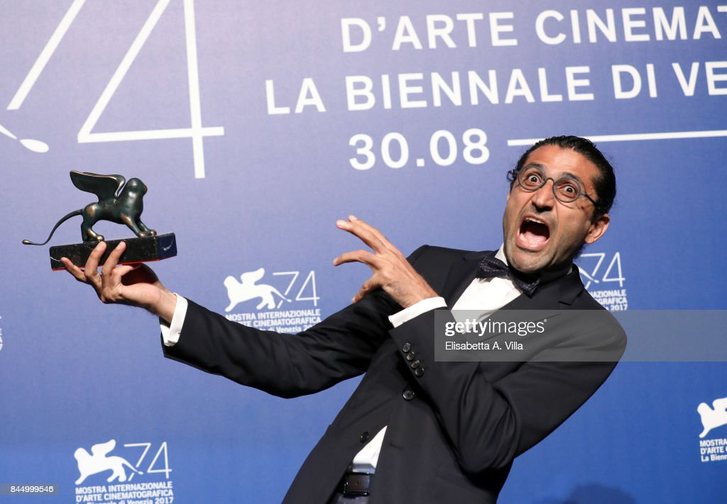 Alireza Khatam poses with the Orizzonti Award for Best Screenplay Award for 'Los Versos Del Olvido' (Oblivion Verses) at the Award Winners photocall during the 74th Venice Film Festival at Sala Casino on September 9, 2017 in Venice, Italy.