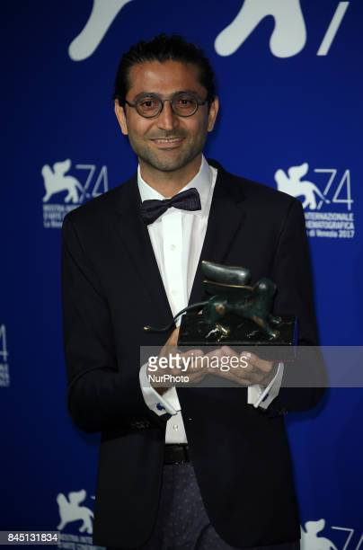 Alireza Khatam poses with the Orizzonti Award for Best Screenplay Award for 'Los Versos Del Olvido' at the Award Winners photocall during the 74th...