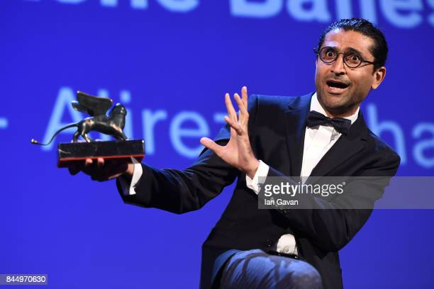 Alireza Khatami receives the Orizzonti Award for Best Screenplay Award for 'Los Versos Del Olvido' during the Award Ceremony of the 74th Venice Film...