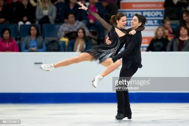 Alisa Agafonova and Alper Ucar of Turkey perform their short program at the 2017 Skate Canada International ISU Grand Prix event in Regina,...