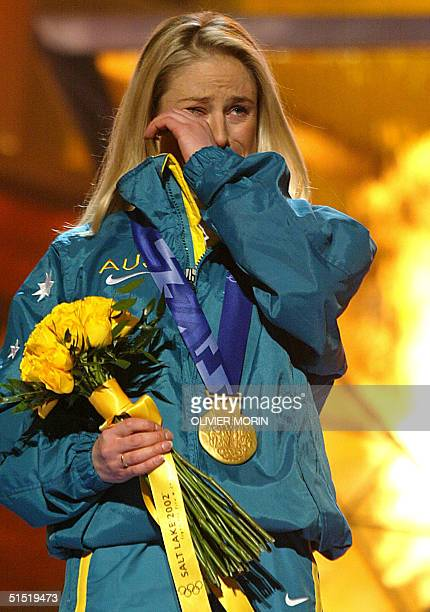 Alisa Camplin of Austrailia sheds tears during the playing of her national anthem after being awarded the gold medal in the Women's Freestyle Aerials...
