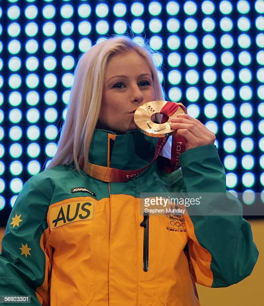 Alisa Camplin of Australia kisses her Bronze medal in the Womens Freestyle Skiing Aerials at the Medals Plaza on Day 13 of the 2006 Turin Winter...