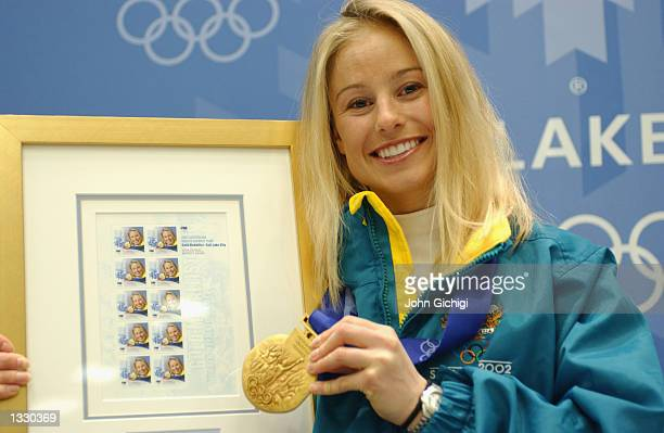 Alisa Camplin one of Australia's two gold medalists poses with her commemorative stamps and gold medal during the Australian Press Conference at the...