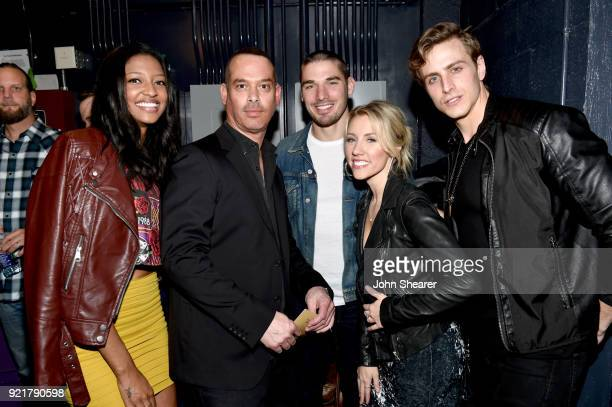 Alisa Fuller producer Adam DiVello Kerry Degman Jessica Mack and Bryant Lowry take photos during CMT's 'Music City' Premiere Party on February 20...