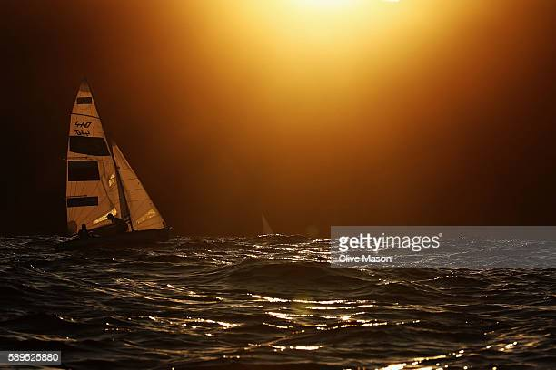 Alisa Kiriliuk of Russia and Liudmila Dmitrieva of Russia sail back to shore after competing in the Women's 470 class on Day 9 of the Rio 2016...