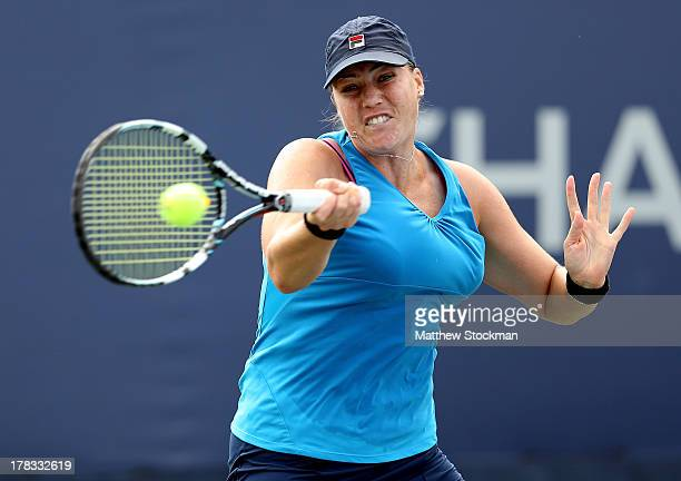 Alisa Kleybanova of Russia plays a forehand during her women's singles second round match against Jelena Jankovic of Serbia on Day Four of the 2013...