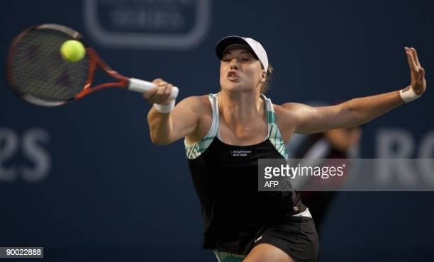 Alisa Kleybanova returns a shot during her semi final match against Maria Sharapova at the Rogers Cup at the Rexall Center on August 22 2009 in...