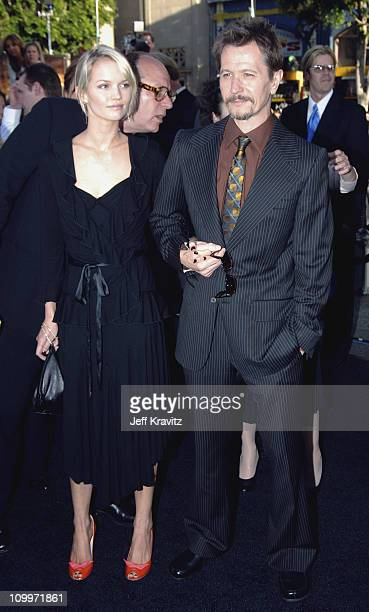 Alisa Marshall and Gary Oldman during Batman Begins Los Angeles Premiere Arrivals at Grauman's Chinese Theater in Hollywood California United States