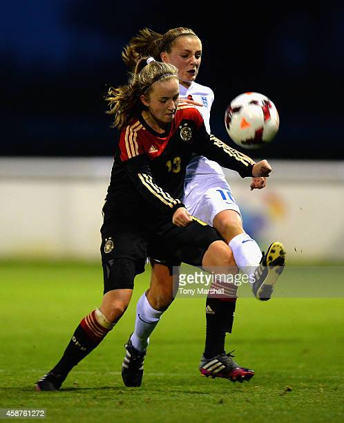 Alisa Pesteritz of Germany is tackled by Georgia Stanway of England during the International Friendly match between U16 Girl's England v U16 Girl's...