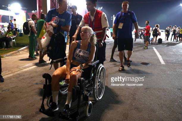 Alisa Vainio of Finland is taken off on a wheelchair after the Women's Marathon on day one of 17th IAAF World Athletics Championships Doha 2019 at...