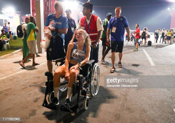 Alisa Vainio of Finland leaves in a wheelchair after the Women's Marathon during day one of 17th IAAF World Athletics Championships Doha 2019 at...