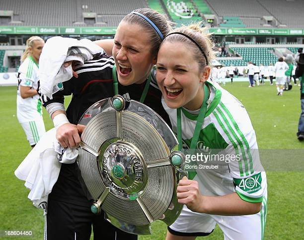 Alisa Vetterlein and her sister Laura Vetterlein of Wolfsburg celebrate with the trophy after winning the german championship after the Women's...