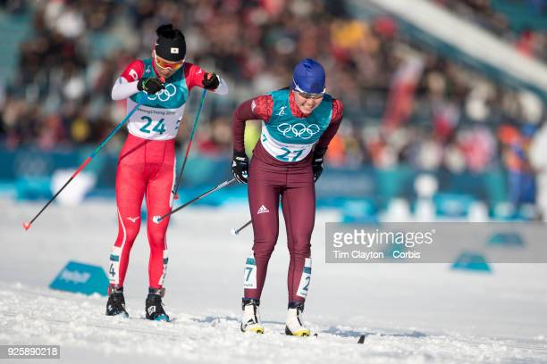 Alisa Zhambalova an Olympic Athlete of Russia and Masako Ishida of Japan in action during the CrossCountry Skiing Ladies' 30km Mass Start Classic at...
